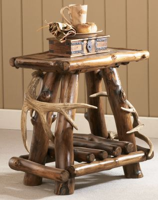 Entertainment Cabelas Exclusive! Bring the rich, rustic feel of a five-star lodge to your home or cabin. The Rustic Lodge End Table combines genuine aspen and faux-antler accents for a truly timeless look. The tabletop panels are made of reclaimed, naturally weathered wood and edged in aspen halves, then lightly sanded and stained a dark brown. The frame is made of small- to medium-sized aspen poles that have been sanded to bring out their natural luster, and then stained a dark brown to match the tabletop. Each piece is sealed with a multilayered polyacrylic coating for long-lasting moisture resistance and a brilliant shine. Features two faux antlers. Made in USA. Dimensions: 24H x 22W x 17D. Color: Dark Brown. - $599.99