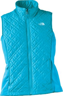 Whether worn alone or as the perfect insulating layer, the Kosmo Vest delivers on both function and fashion with a cool textured face, stretch side panels that move with you and a figure-flattering profile. Tough, yet attractive polyester fleece construction keeps cool temperatures at bay and is lined with comfortable, eco-friendly recycled taffeta. Zip handwarmer pockets. Interior zippered security pocket. Imported.Sizes: S-XL.Colors: TNF Black (not shown), Turquoise Blue. - $89.99